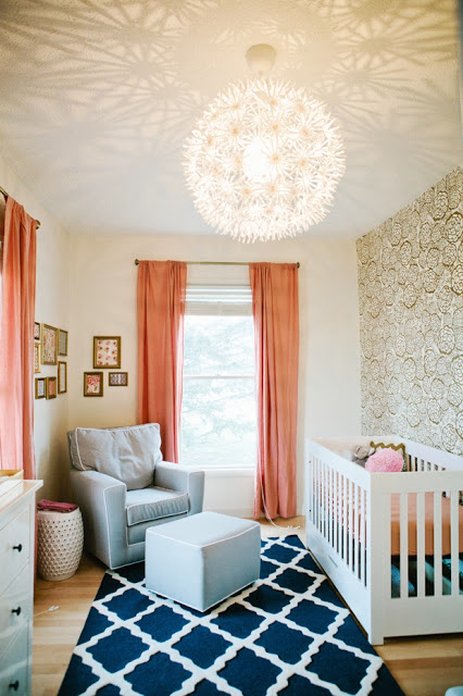 pam cooley nursery blue rug gold wallpaper peach curtains drapery drapes white crib gray rocker white piping baby room